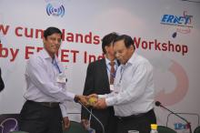 Sh. Praveen Misra being presented a memento